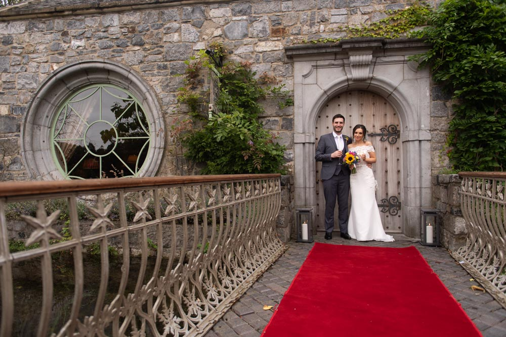Bride and Groom at the front door of the Cliff at Lyons wedding venue