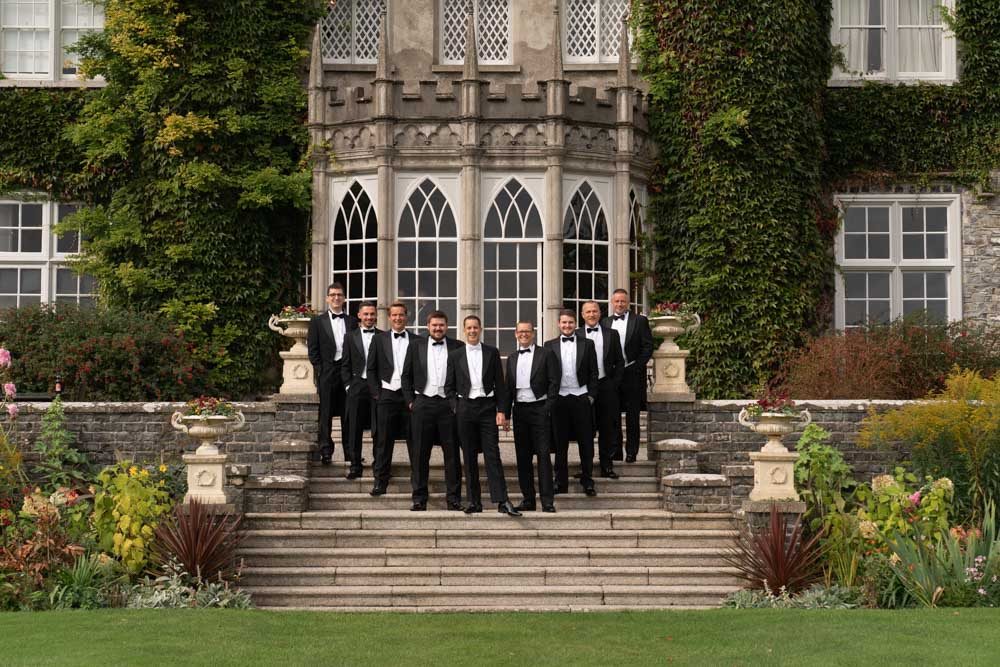 Groom and groomsmen standing on the steps of Luttrellstown Castle