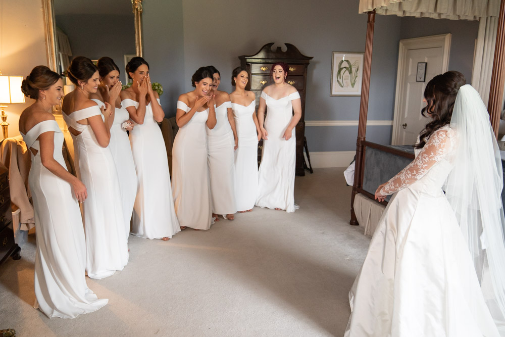 Bridesmaids seeing the Bride for the first time in her wedding dress