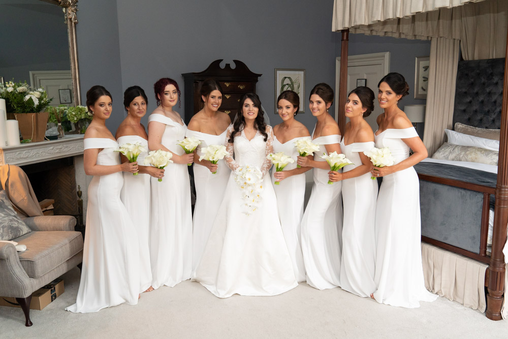 Bride and her bridesmaids in white dresses