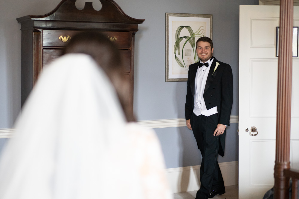 Brides brother seeing her for the first time in her wedding dress for her Ireland Castle wedding