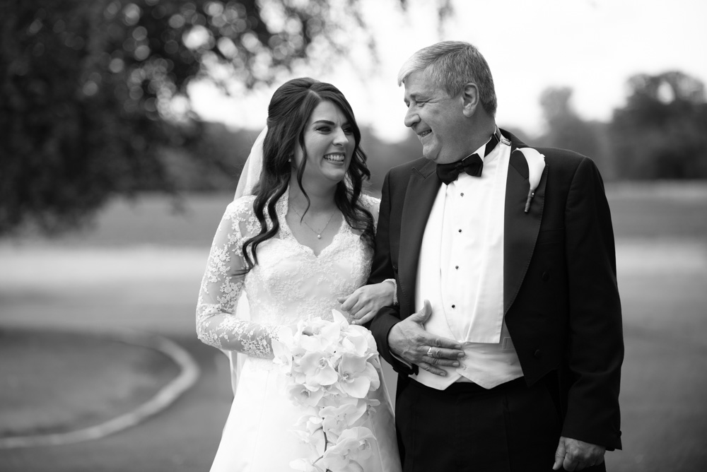 Bride and her dad laughing together