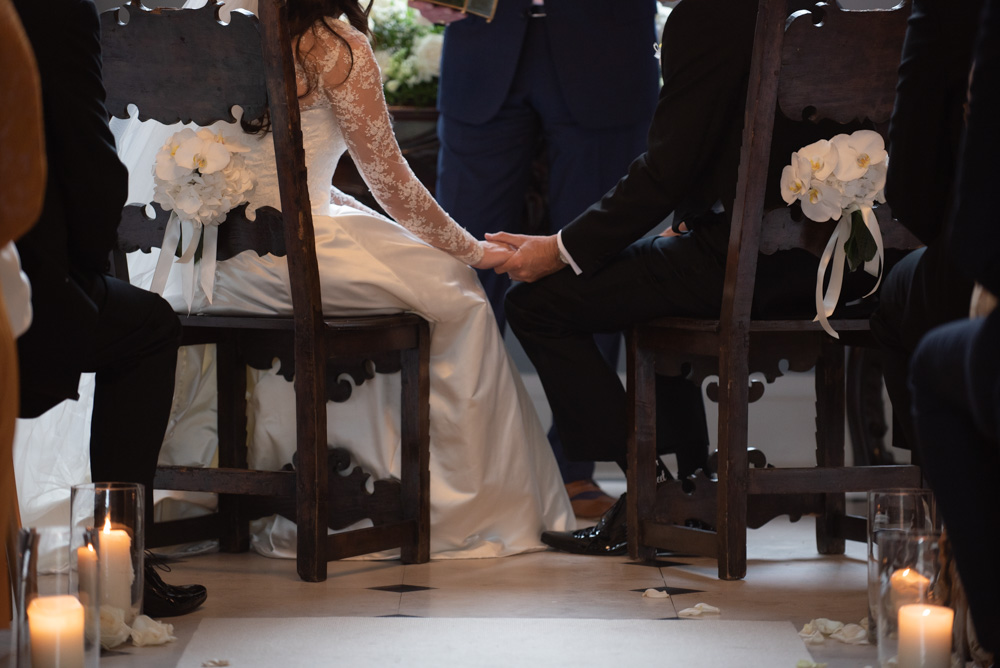 Bride and Groom holding hands at their wedding ceremony at Luttrellstown castle