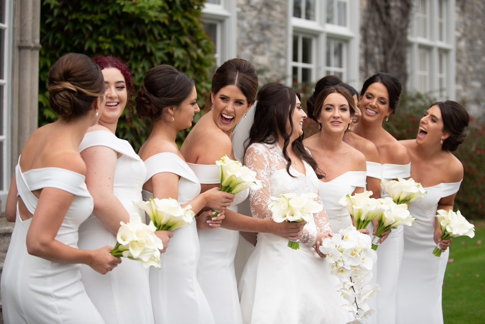 Bride and her bridesmaids laughing together