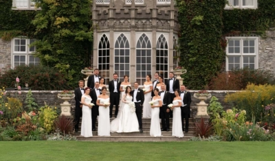 Bride and Groom and their bridal party on the steps of Luttrellstown Castle in Ireland