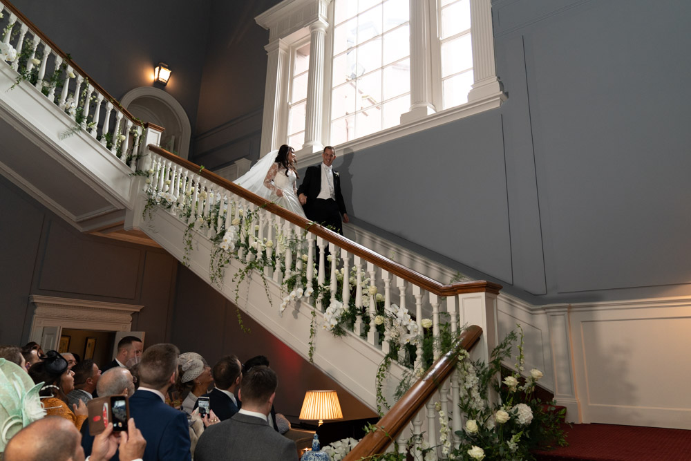 Bride and Groom walking down the staircase at Lutrellstown Castle