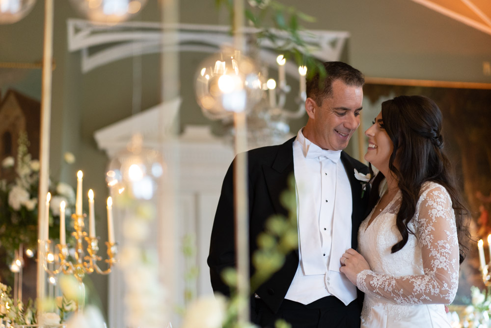 Bride and Groom smiling together in the Reception room at Luttrellstown Castle