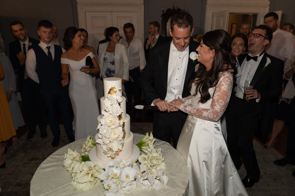 Bride and Groom cutting the cake at their wedding