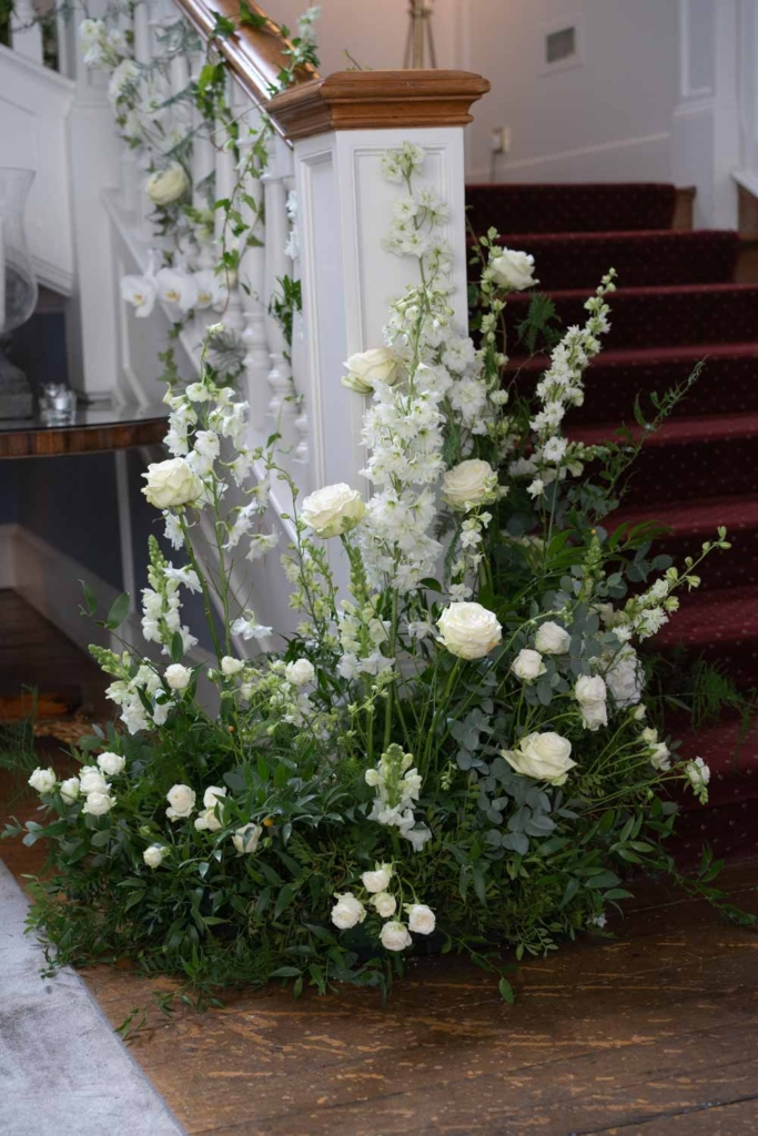 Wedding Flowers on the stairs at Luttrellstown Castle