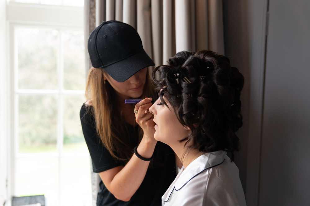 Bride getting her makeup applied for her Ireland Castle wedding