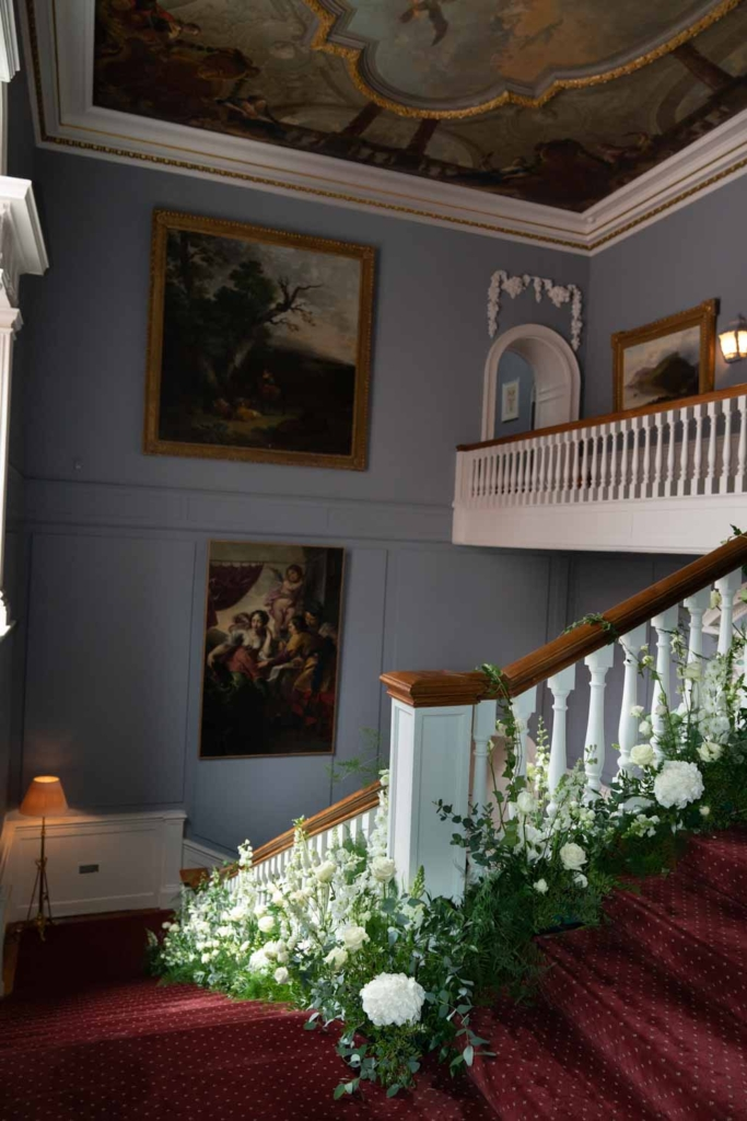 The stairs at Luttrellstown Castle with flowers running down the stairs