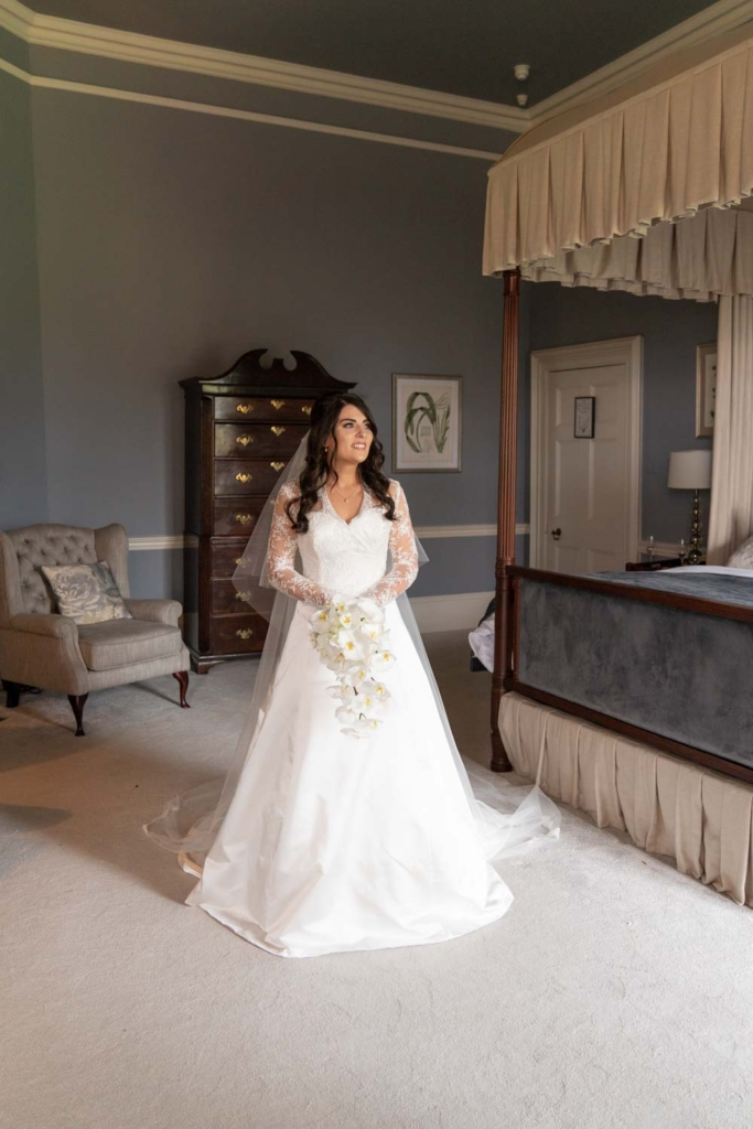 Bride in her wedding dress on the morning of her wedding