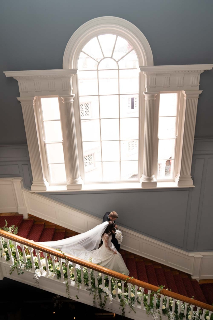 Bride and her dad walking down the stairs at Luttrellstown Castle