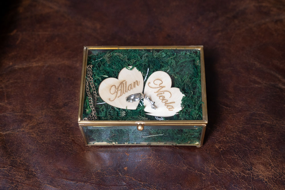 Bride and Grooms wedding bands in a ring box