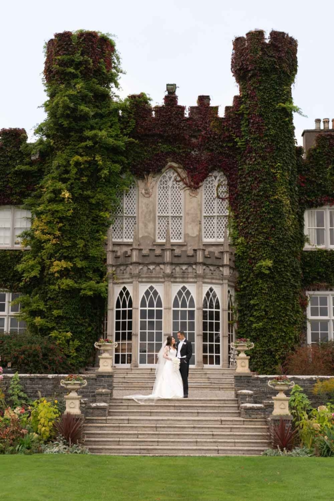 Bride and Groom standing on the steps of Luttrellstown Castle