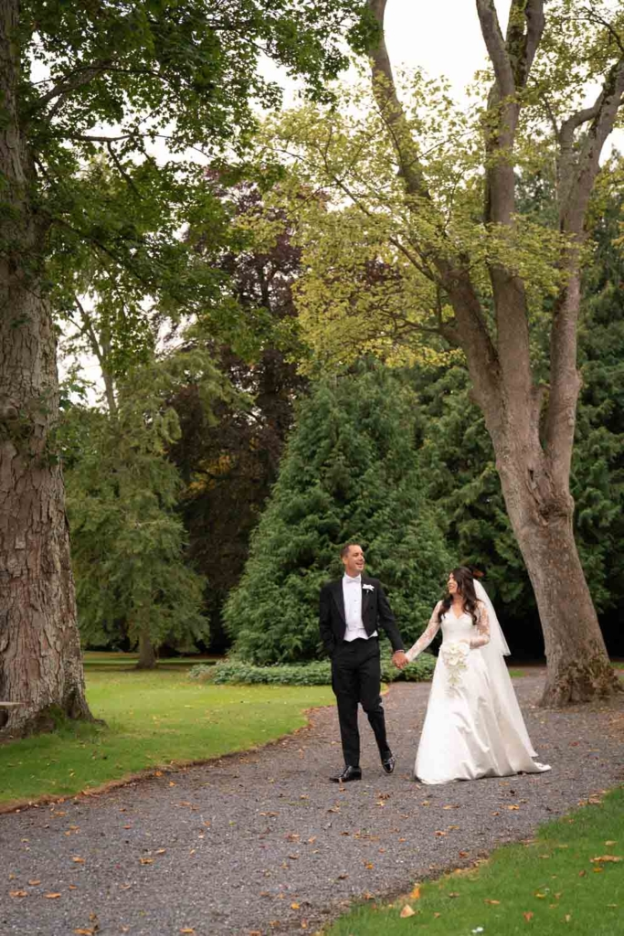 Bride and Groom walking on the grounds of Luttrellstown Castle