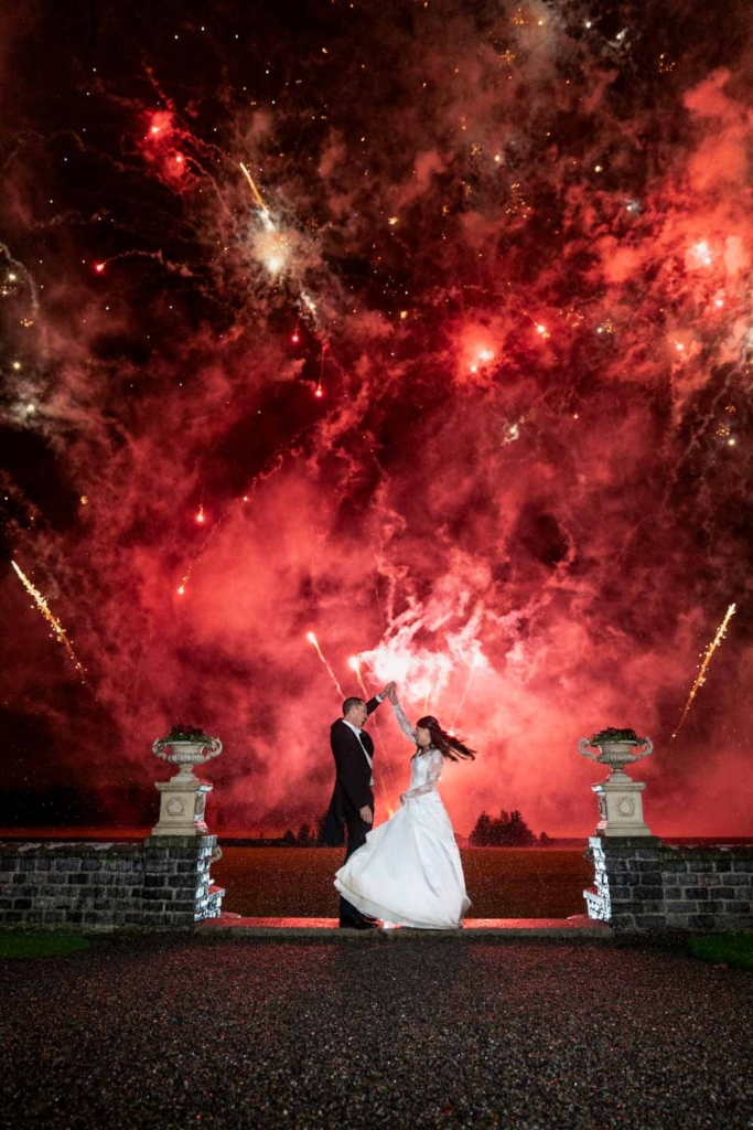 Bride and Groom twirling during the Fireworks at Luttrellstown Castle photo by The Fennells