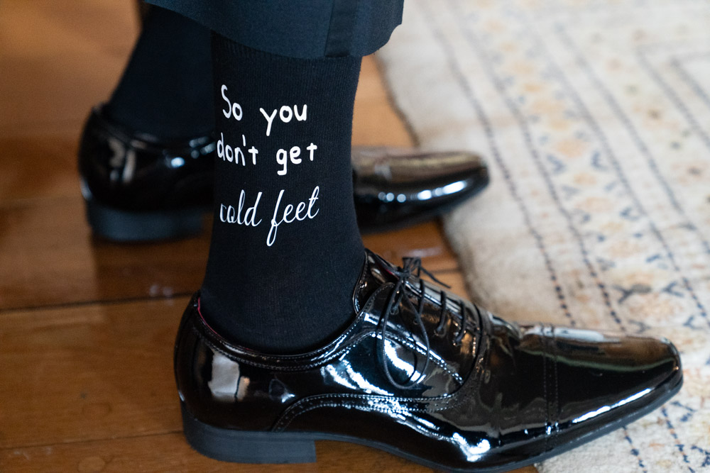 Grooms wedding socks with funny writing on them